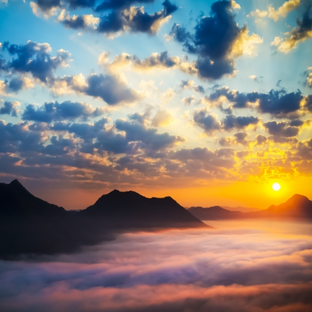 scenario: Sea of clouds on sunrise with ray lighting Stock Photo