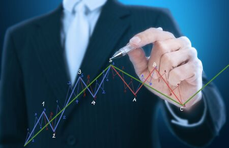 up arrow: businessman writing candle stick graph pattern Stock Photo