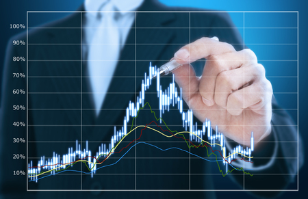 stock market charts: businessman writing candle stick graph pattern Stock Photo