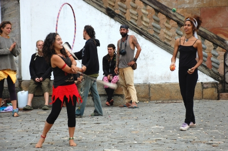 counterculture: OURO PRETO, BRAZIL- MARCH 18 2012 :Members of The Rainbow Family of Living Light loosely affiliated group during a street exhibition in Ouro Preto, Minas Gerais ,Brazil on 18 March 2012 .