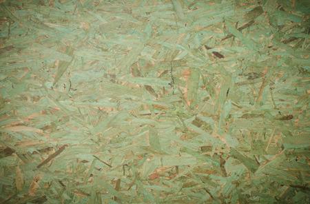 緑背景 OSB (配向性ストランド ボード)。