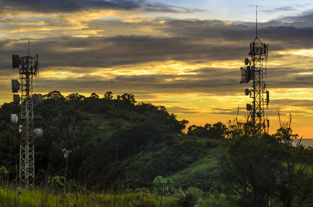 Telecommunications and  radio towers with sunset sky in background on the coast of Sao Paulo state.