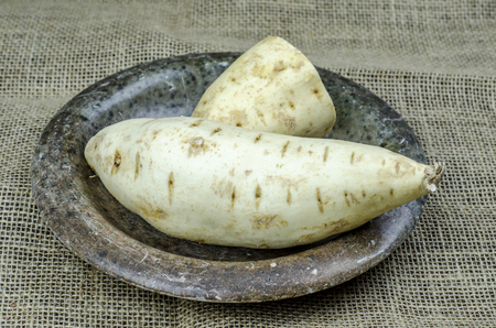 White sweet potatoes on a stone plate .Healthy nutrition concept