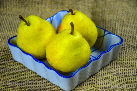 Fresh pears in a ceramic bowl.