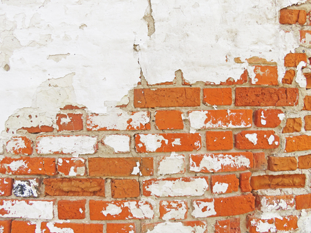 Old Wall of Red Bricks and White Brayed and Cracked Old Paint. Red, Terracotta and White Brick Background. 版權商用圖片