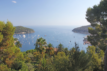 The port or the gulf of the Principality of Monaco. White boats on the blue Sea. Monaco, France. Beautiful seascape. Banco de Imagens