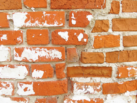 Old Wall of Red Bricks and White Brayed and Cracked Old Paint. Red, Terracotta and White Brick Background. Stock Photo