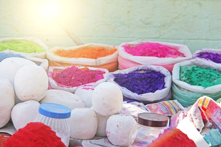 A bright multi-colored powder for drawing mandalas on the ground. India, Hampi.