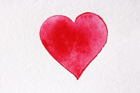 Red heart made from watercolor on a white background.