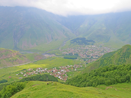 Stepantsminda Village At Evening In Kazbegi District, Mtskheta-Mtianeti Region, Georgia.