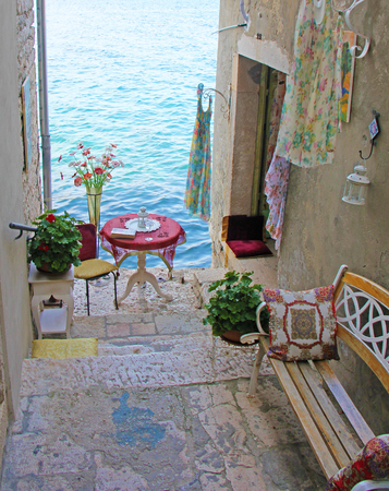 ROVINJ, ISTRIA PENINSULA, CROATIA: Beautiful romantic old town of Rovinj. View of charming narrow stone Streets with colorful shops.