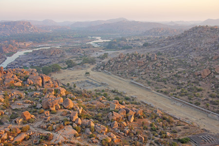 Sunrise in Hampi on Matanga hill. View from above, from the sky, aerophoto.  Indian temple Hampi in the sun.