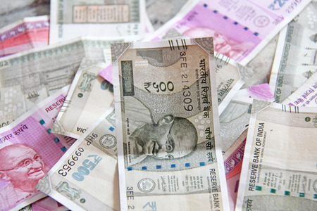 Indian money and banknotes, 500 rupees and 2,000 rupees. Background of paper Indian money. Stock Photo