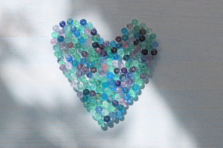 Blue heart made of natural tourmaline stones. Unusual surreal design.