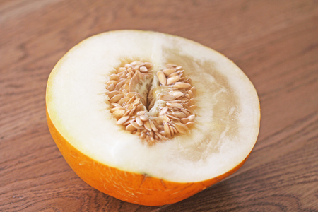 Half a melon in a cut. Sunflower seeds, melon seeds in the cut. Easy eroticism, sex concept.