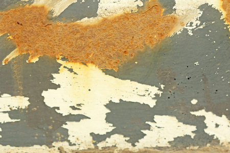 Rusty paint. Corrosion of metal. Rusty gray background.