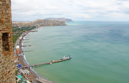Panorama of the city of Sudak, view from the Genoese fortress to the beautiful turquoise and azure sea.