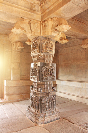 Decorative pillars from black basalt in mandappa or Hall. Hazara Rama Temple Hampi, Karnataka. Stone carving ancient. Indian God bas-relief.