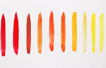 Watercolor bright strips on a white background. Red, yellow, orange strips of watercolors.