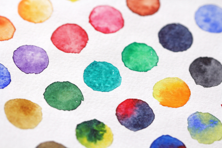 Bright multicolored circles of watercolors. Paper background. Background for decoration and your design. Watercolor background from circles. Green, red, yellow, blue, yellow confetti. Фото со стока