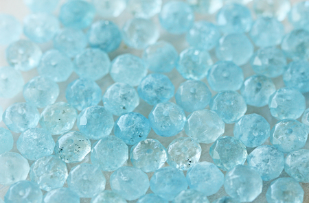 Aquamarine is blue. Natural stone is blue aquamarine. The background is aquamarine. Place for text. Card.