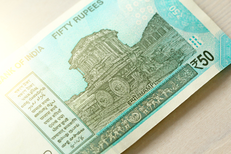 A new banknote of India with a denomination of 50 rupees. Indian currency. The other side, Hampi's chariot.