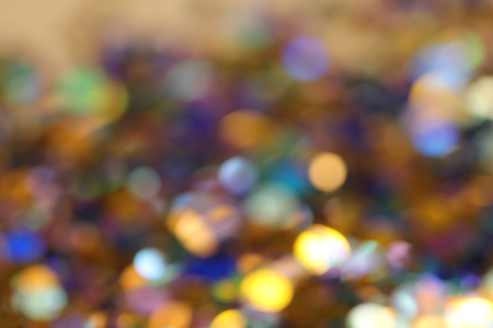 Blurred abstract creative background. Gold and yellow background. Lens flare. Colorful bokeh light. Illuminated burst of multicolor light. Lights of the night and evening city. Blurred circles.