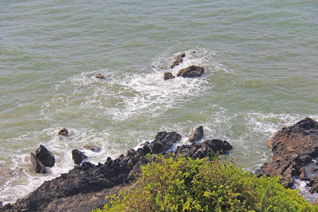 Top view of the sea and rocks. India, GOA,