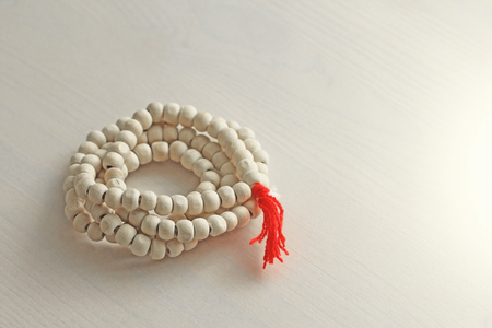 Rosary or beads from the sacred tree of Tulasi with a red tassel.