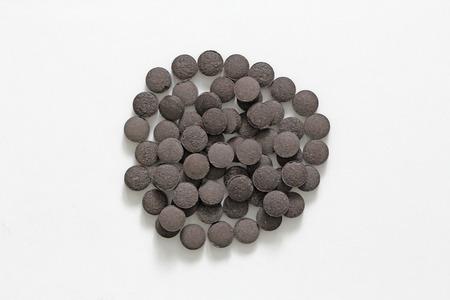 Ayurveda pills. Herbal natural Indian pills, Ayurveda treatment. Ayurvedic medicine herb. Copy space for your text.