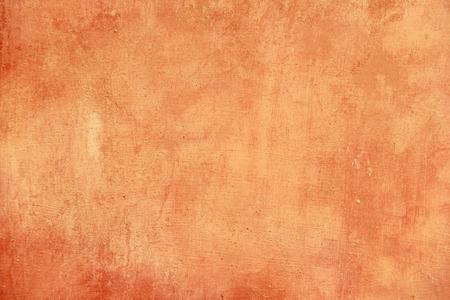 Terre cuite vide et fond orange pour la conception et la conception de couleur terre cuite. Fond de plâtre, pour la conception, la décoration et les modèles.