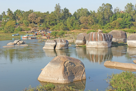 Holy Sacred cow is carved from solid stone on the river Tungabhadra in Hampi.