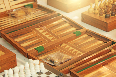 Chess and backgammon are sold in the bazaar market in India. Souvenir gift India. Anjuna, GOA.