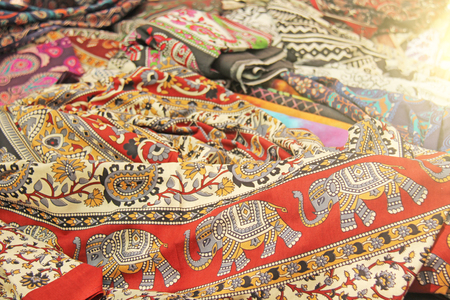 Cloth with elephant India. Red oriental fabric with a pattern and ornament of an elephant.