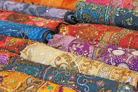Sari. Bright colored fabrics India. It is built on the market. Hand Embroidery India. Tablecloths of different colors are sold at the bazaar in India, Goa.