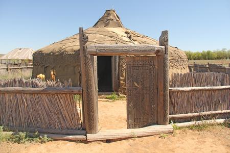 Entrance to the old yurt. Wooden gate and threshold. Sarai Batu.