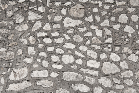 A wall from the Great Old Stones. Gray and Beige Stone Background. Gray Background for Your Design, Decoration, Templates.