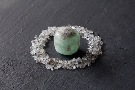 Scattered diamonds on a black background. Raw diamonds and mining, a scattering of natural diamond stones. Graphite quartz. Natural stones and minerals. Stone green Emerald, beryl. Stock Photo