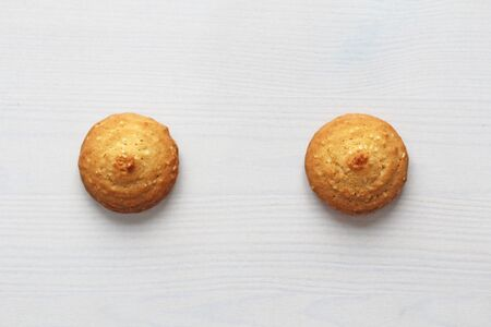 Cookies on a white background, similar to female nipples. Sexy nipples in the form of cookies. Humor, double meaning. Archivio Fotografico