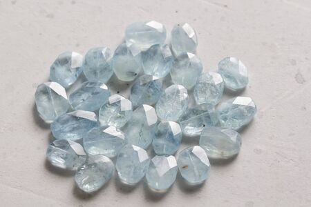 Aquamarine stone. Natural stone and aquamarine crystals on a white background. Beautiful aquamarine stones. 스톡 콘텐츠