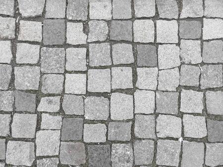 Road from paving stone, texture stones, background of old stones. Old pavement. Foto de archivo