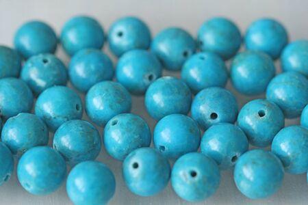 Turquoise. Natural turquoise stone, round beads. Background of turquoise. Turquoise background. Stock Photo