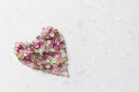 Heart. Beautiful heart made of natural stone tourmaline. Heart on a white background. Greeting card for Valentine's day. Declaration of love. Copy space for your text. Banque d'images - 129186843