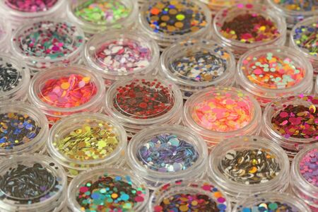 Multi colored Sequins for the design of nails in a Jar. Glitter in jars. Foil for nail service. Photo set. Sparkling beauty shimmer, glitter. Bright background of glitter. Stock fotó