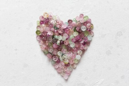 Heart. Beautiful heart made of natural stone tourmaline. Heart on a white background. Greeting card for Valentine's day. Declaration of love. Copy space for your text. Banque d'images - 129187180