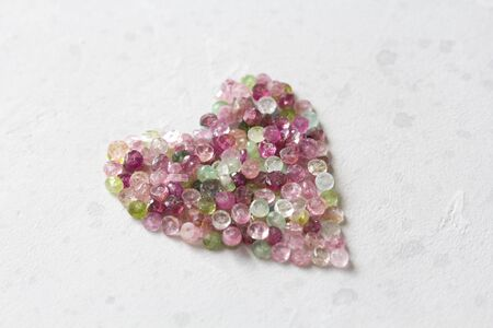 Heart. Beautiful heart made of natural stone tourmaline. Heart on a white background. Greeting card for Valentine's day. Declaration of love. Copy space for your text. Banque d'images - 129187323