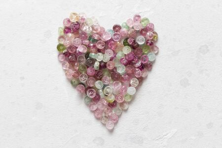 Heart. Beautiful heart made of natural stone tourmaline. Heart on a white background. Greeting card for Valentine's day. Declaration of love. Copy space for your text. Banque d'images - 129187481