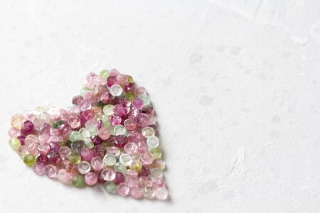 Heart. Beautiful heart made of natural stone tourmaline. Heart on a white background. Greeting card for Valentine's day. Declaration of love. Copy space for your text. Banque d'images - 129187484