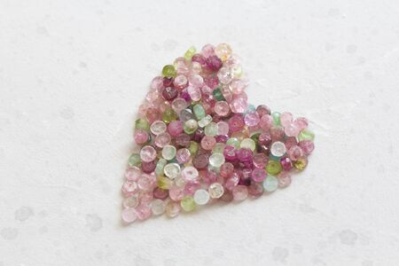 Heart. Beautiful heart made of natural stone tourmaline. Heart on a white background. Greeting card for Valentine's day. Declaration of love. Copy space for your text. Banque d'images - 129187227