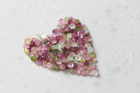 Heart. Beautiful heart made of natural stone tourmaline. Heart on a white background. Greeting card for Valentine's day. Declaration of love. Copy space for your text. Banque d'images - 129187202